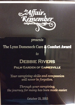 plaque awarding Debbie Rivers the Lynn Domenech Care and Comfort award