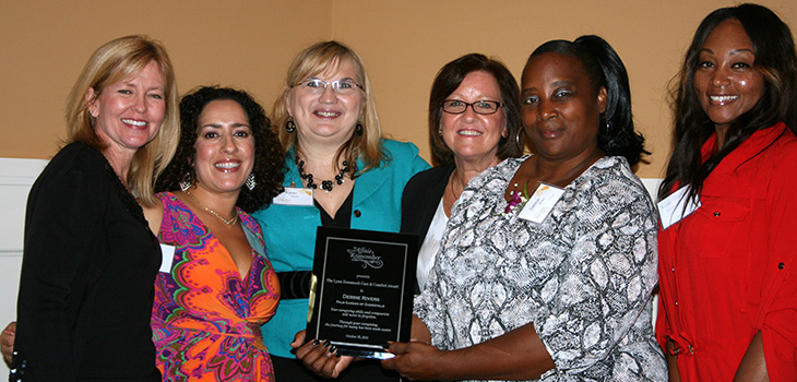 Gainesville staff receiving silver Award for achievement in quality