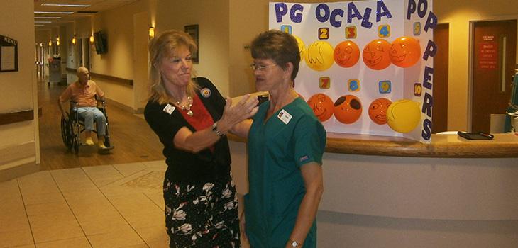 staff member talking to nurse