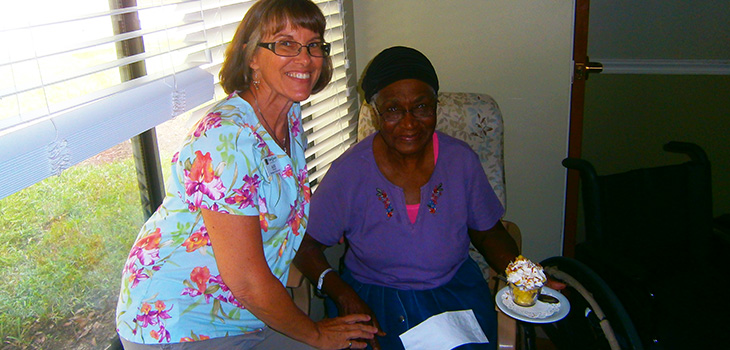 smiling nurse with resident