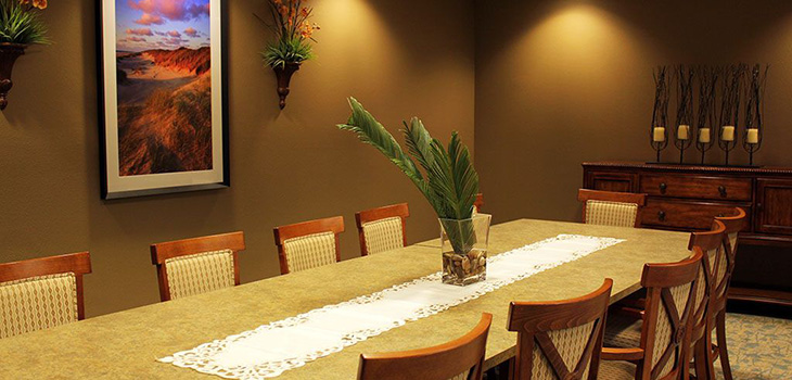 private dining area with artwork on walls and plants for accents