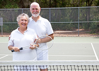 couple enjoying a tennis game