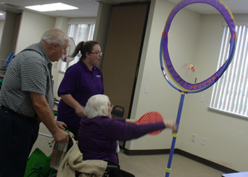 Residents playing games with staff
