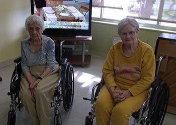 Two residents sitting together in wheelchairs