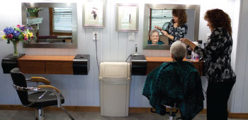 beauty salon area with woman getting her hair cut