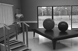 Rehabilitation gym with gym balls on the table