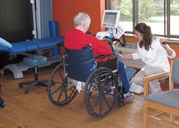 Resident being assisted by rehab staff