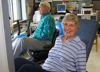 Two residents enjoying a rehab session