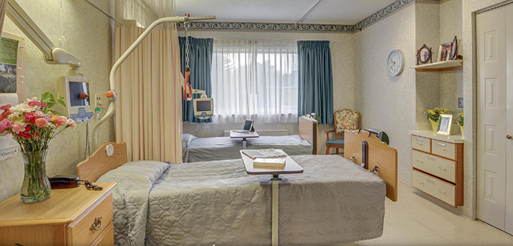 double occupancy room with fresh flowers on the nightstand and dresser